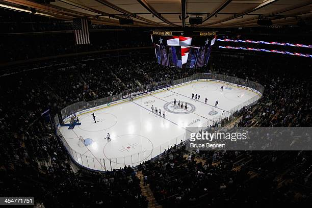 Arena workers convert Madison Square Garden from basketball to hockey configuration on December 8 2013 in New York City