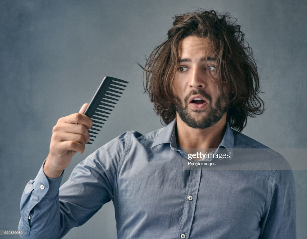 Aren't you suppose to fix the mess on my head? : Stock Photo