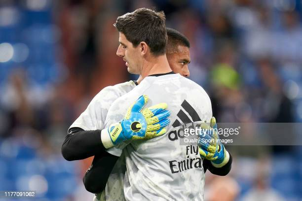 Areola and Thibaut Courtois of Real Madrid CF salute each other prior the game during the Liga match between Real Madrid CF and CA Osasuna at Estadio...