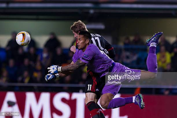 Areola of Villarreal CF and 17 Sebastian Boenisch of Bayer 04 Leverkusen during UEFA Europa League Round of 16 first legs match between Villarreal CF...