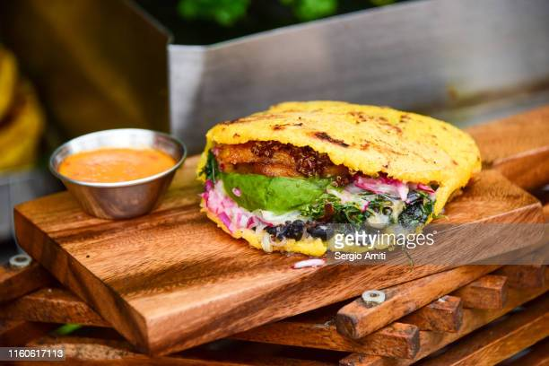 arepa with avocado and plantains - sergio amiti stock pictures, royalty-free photos & images