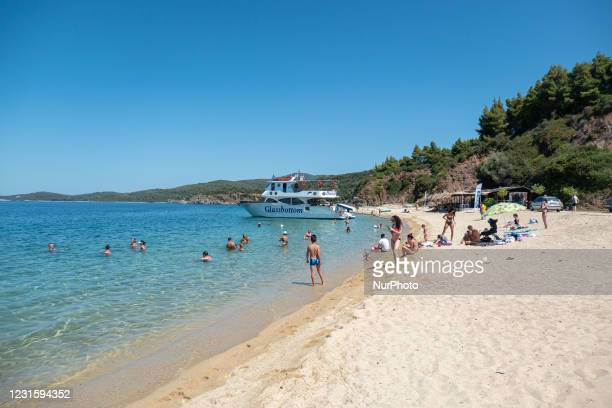 Aretes beach in Toroni area in Halkidiki. The beach with the golden sand and transparent crystal-clear emerald water, typical for the Aegean Sea and...