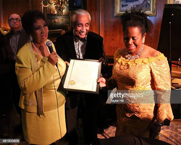 Aretha Franklin accepts a resolution honoring her birthday week presented by Representatives Charles Rangel and Sheila Jackson Lee at Aretha...