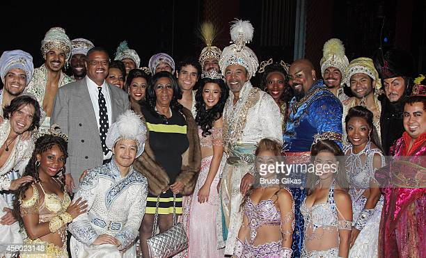 Aretha Franklin and boyfriend William Wilkerson pose with the cast backstage at the hit musical 'Aladdin' on Broadway at The New Amsterdam Theater on...