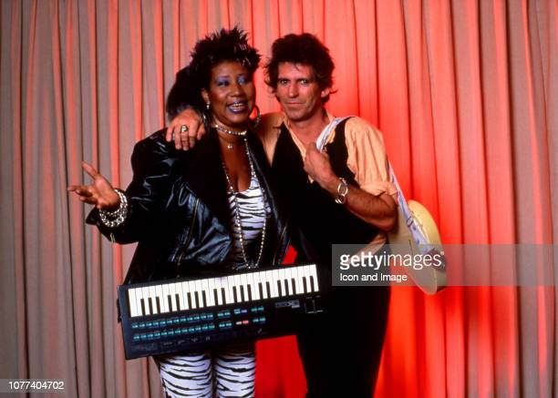 Aretha Franklin and Keith Richards of the Rolling Stones pose for a studio portrait for Aretha's version of Jumpin' Jack Flash for the movie Jumpin'...