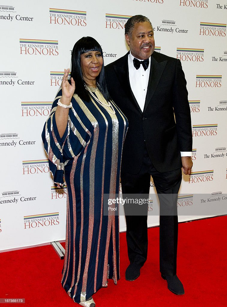 Aretha Franklin and music director Fred Nelson, III arrive for the formal Artist's Dinner honoring the recipients of the 2012 Kennedy Center Honors hosted by United States Secretary of State Hillary Rodham Clinton at the U.S. Department of State December 1, 2012 in Washington, DC. The 2012 honorees are Buddy Guy, actor Dustin Hoffman, late-night host David Letterman, dancer Natalia Makarova, and the British rock band Led Zeppelin (Robert Plant, Jimmy Page, and John Paul Jones).