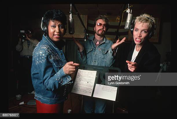 Aretha Franklin performs in a recording studio with Annie Lennox and Dave Stewart of the Eurythmics