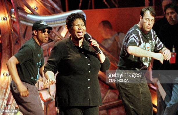 Aretha Franklin rehearses with Blues Brothers Dan Akroyd Joe Morton 22 February at Radio City Music Hall in New York for the 40th Annual Grammy...