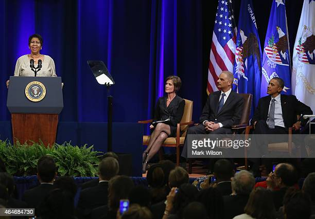 Aretha Franklin sings America The Beauiful as US President Barack Obama US Attorney General Eric Holder and acting Attorney General Sally Quillian...