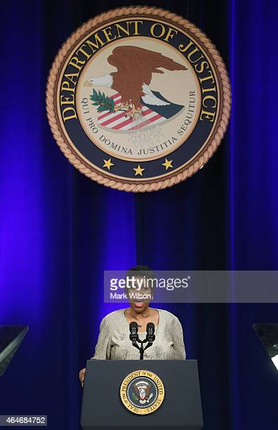 Aretha Franklin sings America The Beauiful during a portrait unveiling ceremony for outgoing Attorney General Eric Holder at the Justice Department...