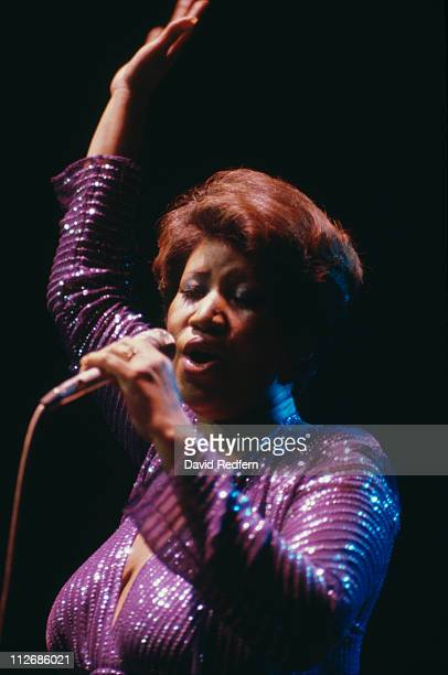 Aretha Franklin US soul singer singing into a microphone during a live concert performance circa 1980