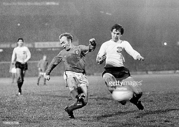 Arfon Griffiths scores the winning goal for Wales against Austria during their European Championship Qualifying match played at the Racecourse Ground...