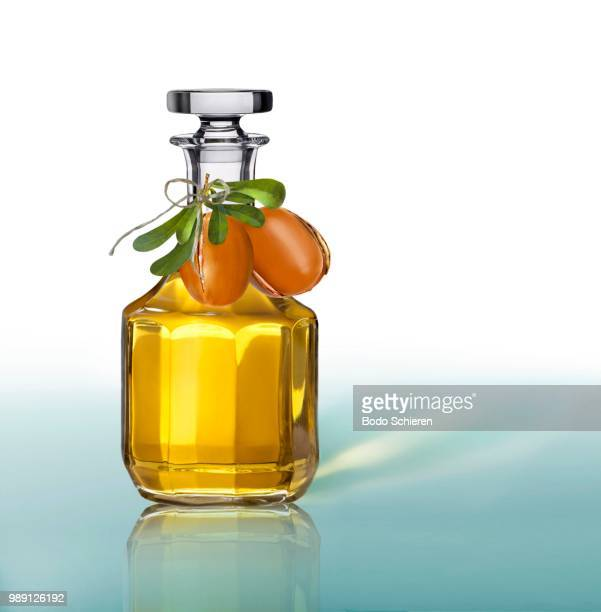 argan oil in a carafe - argan tree stock pictures, royalty-free photos & images