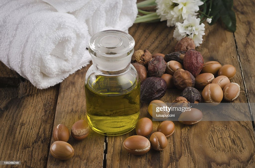 Argan oil with fruits : Stock Photo