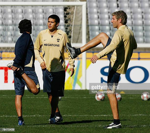 Argantine football club Boca Juniors forward Martin Palermo and midfielder Juan Riquelme work out during the practice session in Yokohama 14 December...