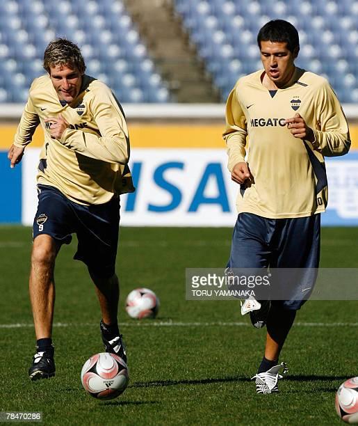 Argantine football club Boca Juniors forward Martin Palermo passes a ball to midfielder Juan Riquelme during a practice session in Yokohama 14...