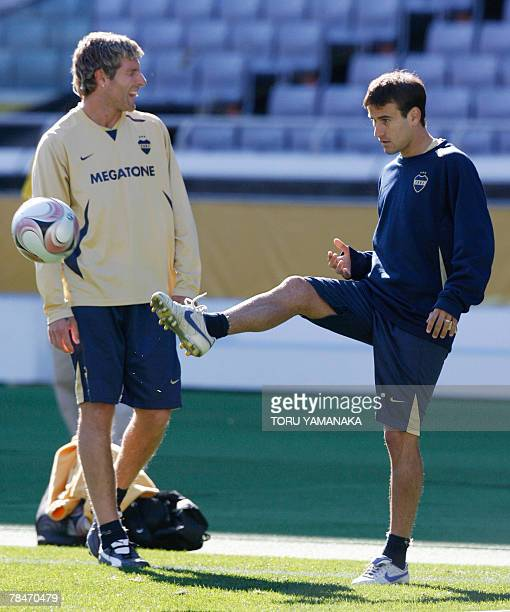 Argantine football club Boca Juniors forward Rodrigo Placio kicks a ball beside Martin Palermo during the practice session in Yokohama 14 December...