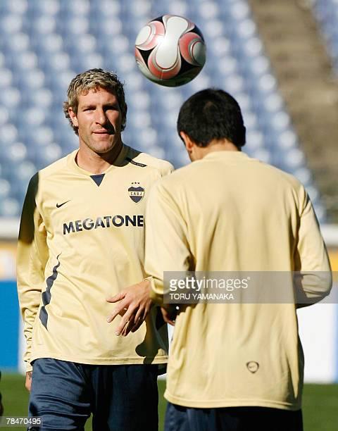 Argantine football club Boca Juniors midfielder Juan Riquelme heads a ball to forward Martin Palermo during the practice session in Yokohama 14...