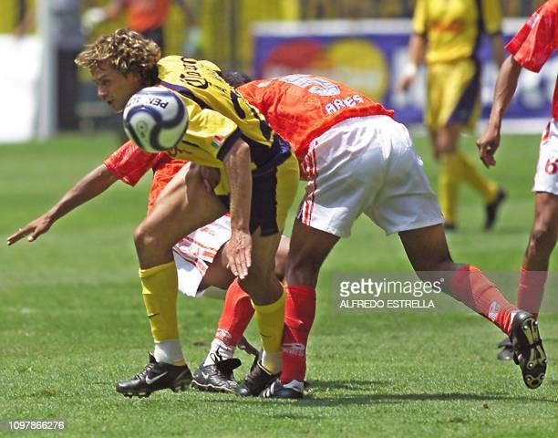Argemiro Veiga of the America team fights for the ball against Gilberto Flores of the Cienciano de Peru team during the Copa Libertadores competition...