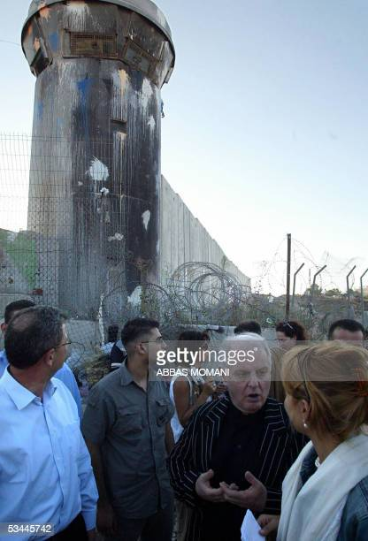 ArgentianIsraeli orchestra conductor Daniel Barenboim visits 20 August 2005 Israel's separation barrier at Qalandyah checkpoint in the West Bank city...