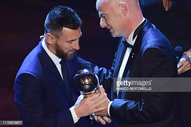 Argentina and Barcelona forward Lionel Messi is presented by FIFA President Gianni Infantino with the trophy for the Best FIFA Men's Player of 2019...