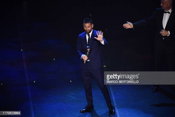 Argentina and Barcelona forward Lionel Messi reacts after winning the trophy for the Best FIFA Men's Player of 2019 Award, presented by FIFA...