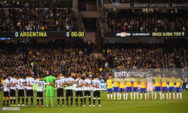 Argentina and Brazil stand for a minute silence during the Brazil Global Tour match between Brazil and Argentina at Melbourne Cricket Ground on June...