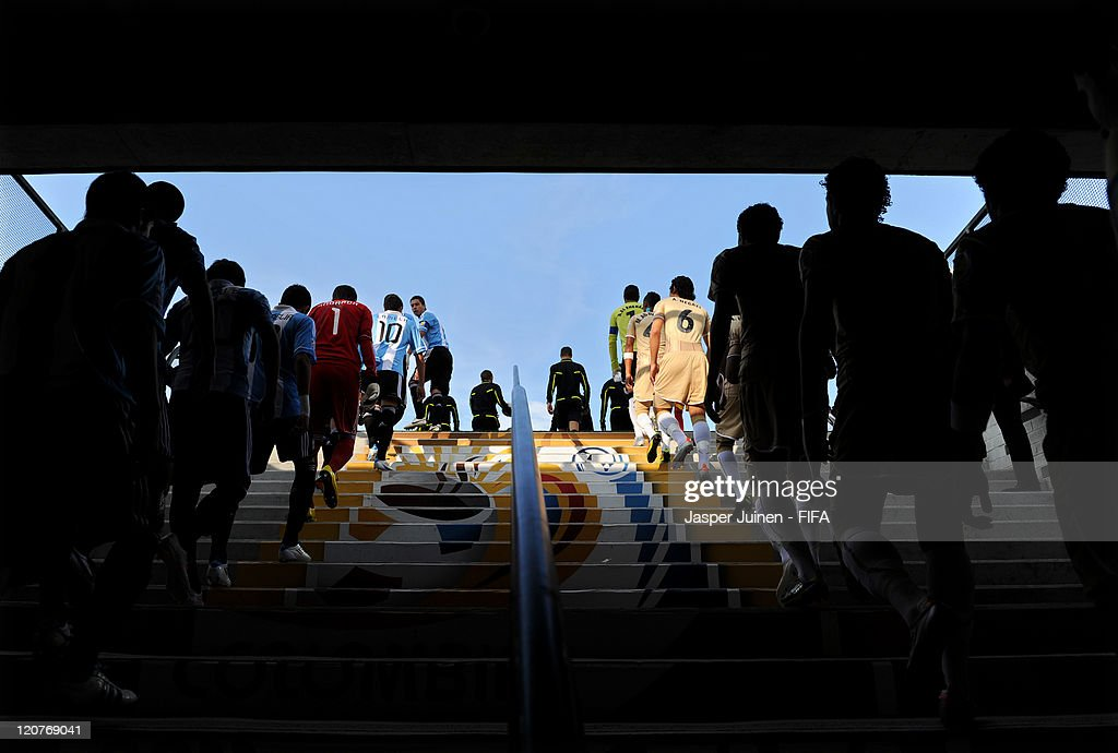 Argentina (L) and Egypt players enter the pitch for the start of the FIFA U-20 World Cup Colombia 2011 round of 16 match between Argentina and Egypt at the Atanasio Girardot stadium on August 9, 2011 in Medellin, Colombia.