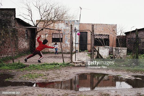 Argentina, Buenos Aires, children playing in yard outside house