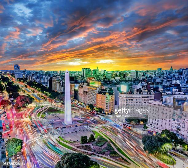 argentina buenos aires downtown with traffic cars at night arround the obelisco - argentina stock pictures, royalty-free photos & images