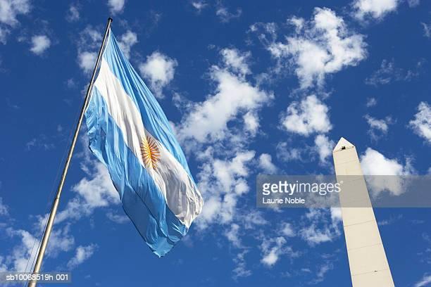 Argentina, Buenos Aires, Obelisco Avenida 9 de Julio and flag
