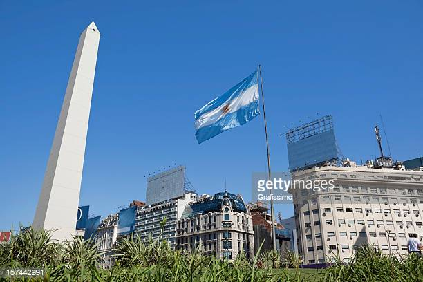argentina buenos aires obelisco with argentine flag - buenos aires stock pictures, royalty-free photos & images