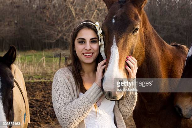 Argentina, Buenos Aires, Partido del Pilar, Manzanares, Portrait of teen (14-15) girl stroking horse