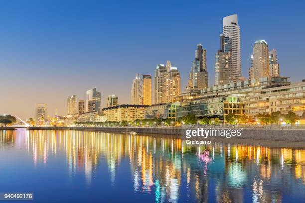 argentina buenos aires skyline puerto madero at night - buenos aires stock pictures, royalty-free photos & images
