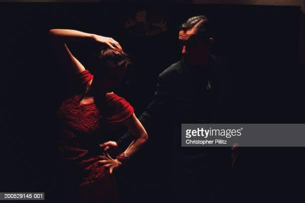 Argentina, Buenos Aires, tango dancers in dark