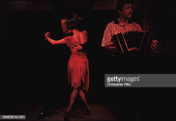Argentina, Buenos Aires, tango dancers in red light