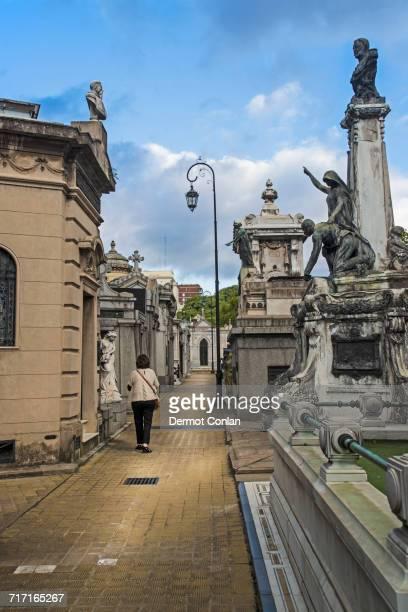 Argentina, Buenos Aires, Woman walking through Recoleta Cemetery