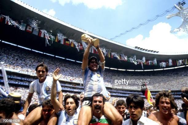 Argentina captain Diego Maradona holds the World Cup trophy aloft.