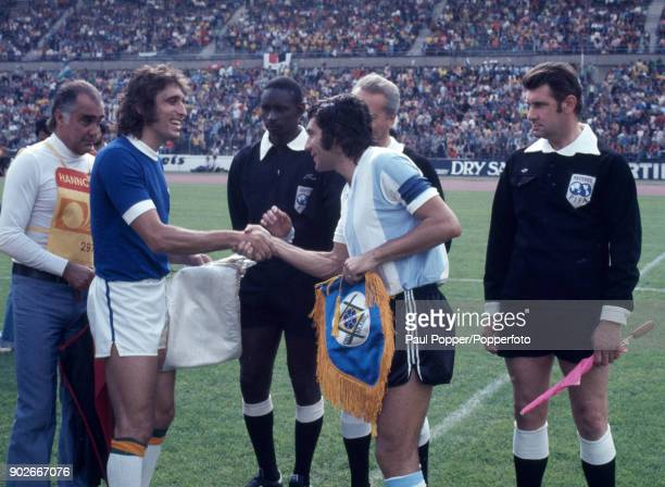 Argentina captain Miguel Brindisi meets Marinho Peres of Brazil watched by the match officials including English linesman Jack Taylor prior to the...