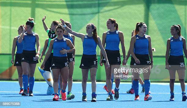 Argentina celebrate after their 50 victory during the Women's pool B hockey match between Argentina and India on Day 8 of the Rio 2016 Olympic Games...