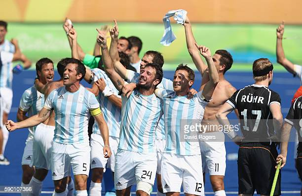Argentina celebrate after their 52 victory during the Men's semi final hockey match between Argentina and Germany on Day 11 of the Rio 2016 Olympic...