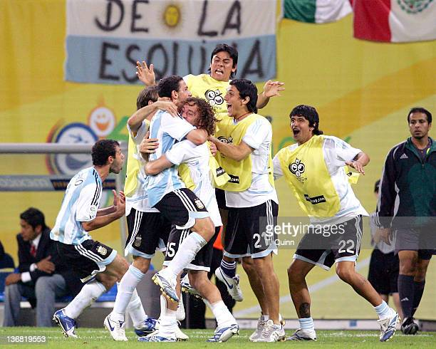 Argentina celebrate Mazi Rodriguez' game winning goal during the Round of 16 match against Mexico at Zentralstadion in Leipzig Germany on June 24...