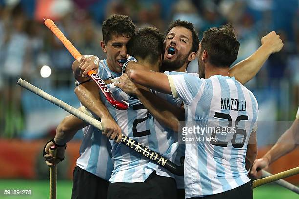 Argentina celebrate the goal scored by Gonzalo Peillat of Argentina during the Men's Hockey Gold Medal match between Belgium and Argentina on Day 13...