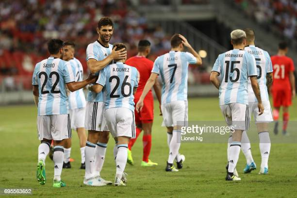 Argentina celebrate the third goal scored by Alejandro Gomez of Argentina during the international friendly match between Argentina and Singapore at...