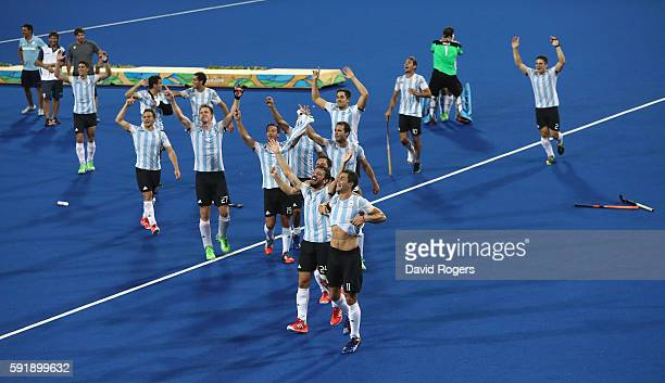 Argentina celebrate their 42 victory to win the gold medal during the Men's Gold Medal match between Argentina and Belgium on Day 13 of the Rio 2016...