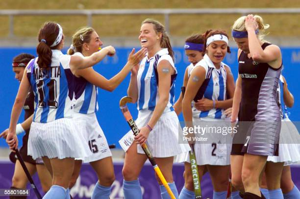 Argentina celebrate their win as New Zealand's Anna Lawrence walks off the pitch in their Womens Hockey match at the 2000 Sydney Olympics Wednesday...