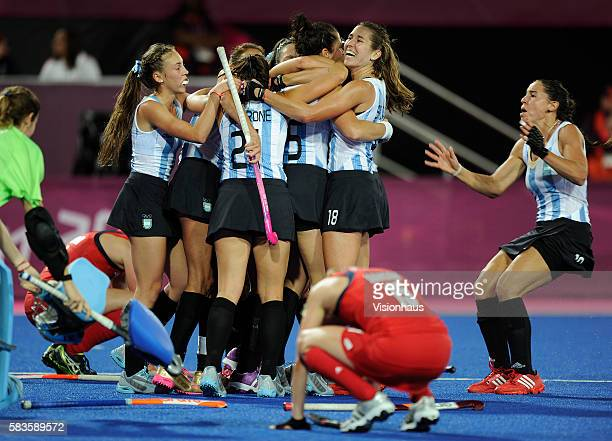Argentina celebrate victory while Great Britain are left disappointed during the Womens Hockey semi final between Great Britain and Argentina as part...