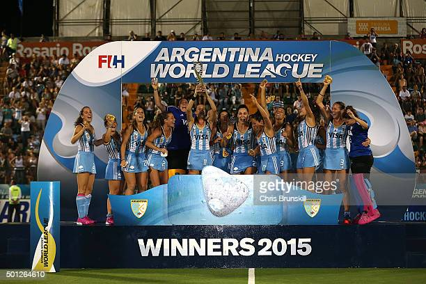 Argentina celebrate victory with the trophy at the end of the final match between Argentina and New Zealand on day 9 of the Hockey World League Final...