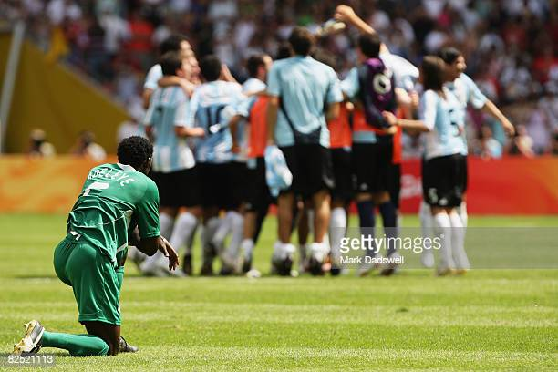Argentina celebrate winning the Men's Gold Medal football match between Nigeria and Argentina as Dele Adeleye of Nigeria looks on at the National...