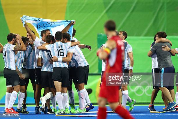 Argentina celebrate winning the Men's Hockey Gold Medal match between Belgium and Argentina on Day 13 of the Rio 2016 Olympic Games at Olympic Hockey...